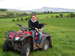 Ian sitting on quad-bike